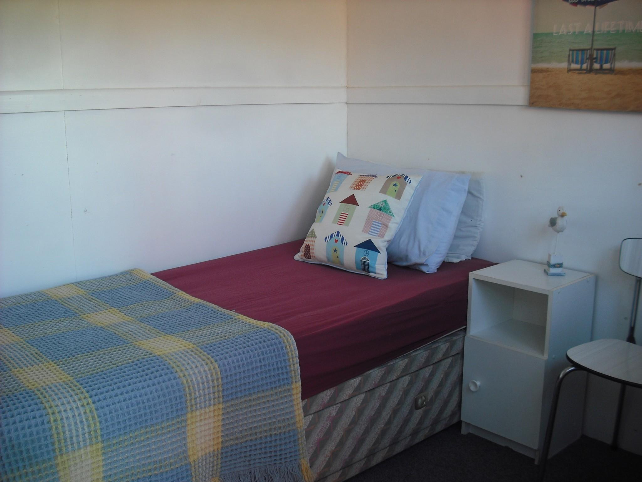 Bed inside Glamping hut