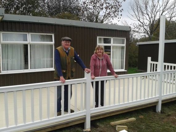 Two people standing on plastic decking