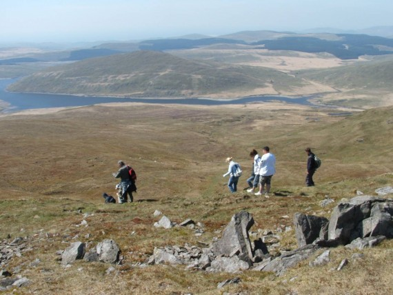 View over Plynlumon with group og walkers